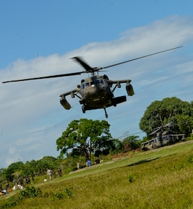 A U.S. Army UH-60 Blackhawk takes off with Honduran soldiers and their equipment, Nov. 5, 2015, in the Gracias a Dios department (state) of Honduras during Operation CARAVANA XIII, a troop rotation in the area. The helicopters, assigned to the 1-228th Aviation Regiment at Soto Cano Air Base, Honduras, fulfilled a Honduran military request for airlift to aid in Honduran freedom of movement in the area, helping them to combat drug trafficking and related criminal activities.. (U.S. Air Force photo by Capt. Christopher J. Mesnard/Released)