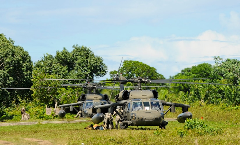 Two U.S. Army UH-60 Blackhawks assigned to the 1-228th Aviation Regiment take on Honduran soldiers, Nov. 5, 2015, in the Gracias a Dios department (state) of Honduras, during an ongoing partnership between the U.S. and Honduras to aid the Honduran military's freedom of movement in the area. Over 300 Honduran soldiers were rotated to and from various forward operating locations to help prevent the trafficking of people and drugs in the area. (U.S. Air Force photo by Capt. Christopher J. Mesnard/Released)
