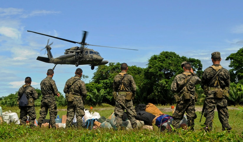 A U.S. Army UH-60 Blackhawk takes off with Honduran soldiers and their equipment, Nov. 5, 2015, in the Gracias a Dios department (state) of Honduras as other soldiers await transport to forward operating posts in the area. The helicopters, assigned to the 1-228th Aviation Regiment at Soto Cano Air Base, Honduras, fulfilled a Honduran military request for airlift to aid in their freedom of movement in the area, helping them to combat drug trafficking and related criminal activities. (U.S. Air Force photo by Capt. Christopher J. Mesnard/Released)