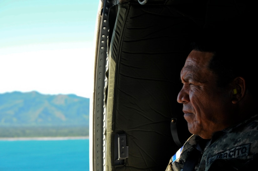 Honduran Army Lt. Col. Giron rides in a U.S. Army UH-60 Blackhawk, Nov. 5, 2015, en route to a Honduran naval base in the Gracias a Dios department (state) of Honduras. Giron served as the senior Honduran military representative during a troop rotation Joint Task Force-Bravo supported to give the Hondurans a greater freedom of access and movement in the district. (U.S. Air Force photo by Capt. Christopher J. Mesnard/Released)