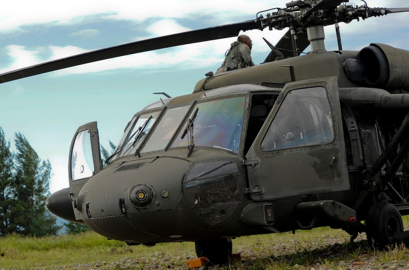 A 1-228th Aviation Regiment UH-60 Blackhawk pilot inspects his aircraft prior to a mission Nov. 5, 2015, in the Gracias a Dios department (state) of Honduras during the Operation CARAVANA XIII Honduran troop movement. In total, the 1-228th assisted the Hondurans in moving more than 300 personnel in support of the operation, designed to counter trans-national organized crime in the Central American area of operations. (U.S. Air Force photo by Capt. Christopher J. Mesnard/Released)