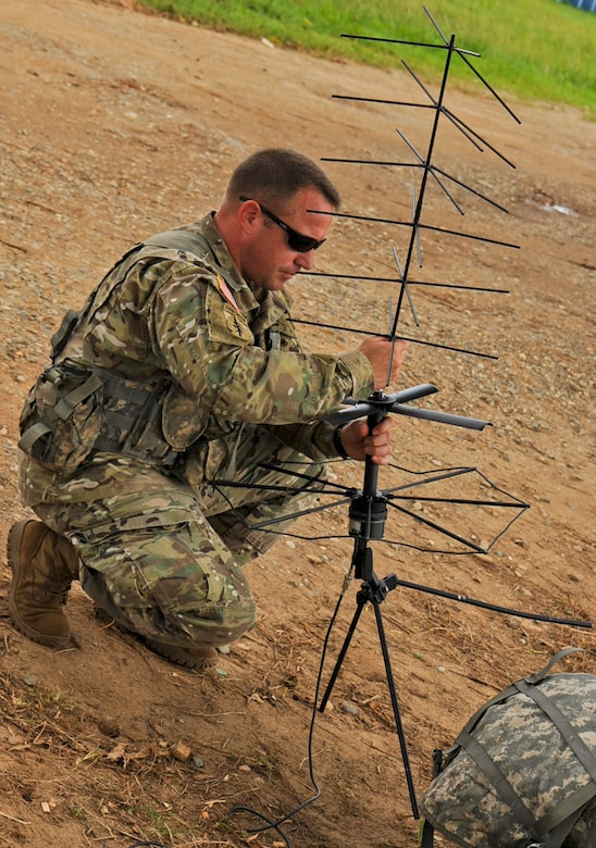U.S. Army Capt. John Dills, Joint Task Force-Bravo officer in charge, sets up an antenna for communications capabilities during the Honduran troop movement, Operation CARAVANA XIII, Nov. 4, 2015, in the Gracias a Dios department (state) of Honduras. Dills provided command and control capabilities for the Honduran troop movement, which U.S. Army UH-60 Blackhawks supported with airlift capabilities, giving the Hondurans greater freedom of movement to counter drug trafficking and related criminal activities. (U.S. Air Force photo by Capt. Christopher J. Mesnard/Released)