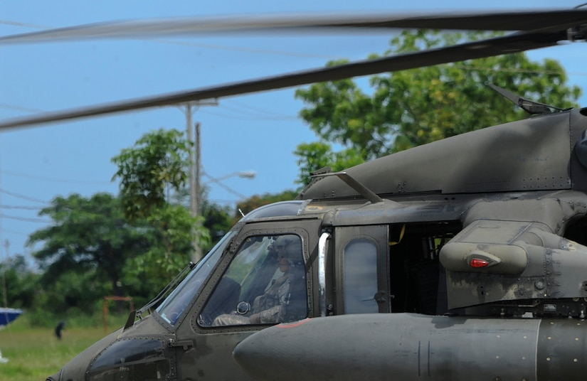 A U.S. Army UH-60 Blackhawk waits at a helicopter landing zone, Nov. 4, 2015, in the Gracias a Dios department (state) of Honduras while supporting a Honduran request to move soldiers in the area. The Honduran soldiers are a part of a rotation in the area to help stem the flow of drugs trafficking and related criminal activities in the Gracias a Dios District. (U.S. Air Force photo by Capt. Christopher J. Mesnard/Released)
