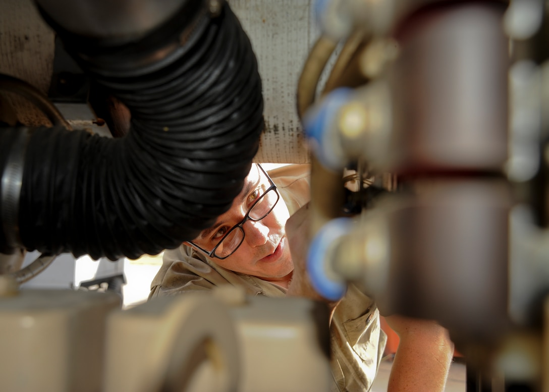 Senior Airman Joshua Farr, 22nd Maintenance Squadron aerospace ground equipment flight journeyman, inspects a generator, Nov. 5, 2015, at McConnell Air Force Base, Kan. The AGE flight monitors, inspects and maintains more than 500 pieces of equipment used across the entire 22nd Maintenance Group. (U.S. Air Force photo/Senior Airman Victor J. Caputo)