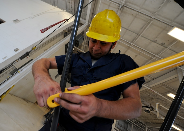 Senior Airman Jose Dominguez, 22nd Maintenance Squadron aerospace ground equipment flight journeyman, secures braces on a B-5 stand, Nov. 5, 2015, at McConnell Air Force Base, Kan. The AGE flight is responsible for maintaining and providing gear to other maintenance Air Force specialty codes for aircraft troubleshooting. (U.S. Air Force photo/Senior Airman Victor J. Caputo)