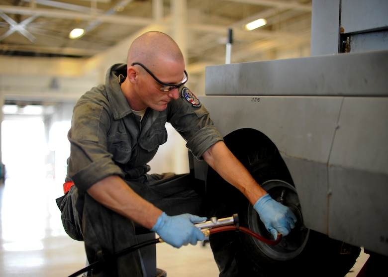 Senior Airman Mark Hudson, 22nd Maintenance Squadron aerospace ground equipment flight journeyman, inflates a tire on a diesel generator, Nov. 5, 2015, at McConnell Air Force Base, Kan. The AGE flight is responsible for maintaining and providing gear to other maintenance Air Force specialty codes for aircraft troubleshooting. (U.S. Air Force photo/Senior Airman Victor J. Caputo)