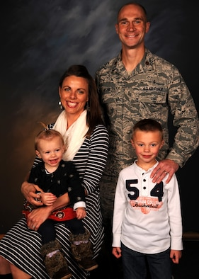 Maj. Corby Heyne, his wife Kristin and children, Kaison and Kinley, have been stationed at Grand Forks Air Force Base, North Dakota, for more than a year. Major Heyne is the 319th Medical Support Squadron medical readiness and logistics flight commander. They have experienced many of the challenges associated with being a military family, but Kristin and her children have supported Major Heyne from behind the scenes to ensure that he can support the Air Force mission. (U.S. Air Force photo by Airman 1st Class Ryan Sparks/Released)
