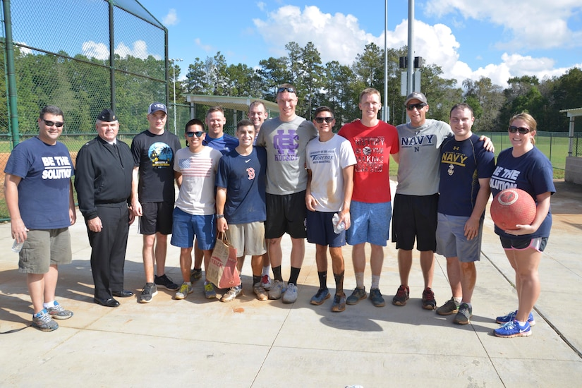 """Members of the """"Full Power Lineup"""" kickball team representing Naval Nuclear Power Training Command (NNPTC) pose for a group photo after coming in 2nd place at a kickball tournament on Joint Base Charleston-Naval Weapons Station Nov. 7, 2015. The event was hosted by the Navy's Sexual Assault Prevention and Response team. (U.S. Navy photo by Mass Communication 3rd Class John Haynes/Released)"""