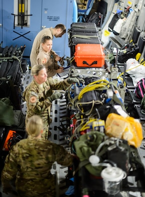 Medical personnel construct an aeromedical evacuation zone inside of a C-17 Globemaster III Nov. 10, 2015, at Ramstein Air Base, Germany. A variety of medical personnel, including Ramstein's 10th Expeditionary Aeromedical Evacuation Squadron, flew to a deployed location to bring injured Airmen, Soldiers and Sailors to medical facilities capable of treating their injuries. (U.S. Air Force photo/Staff Sgt. Armando A. Schwier-Morales)