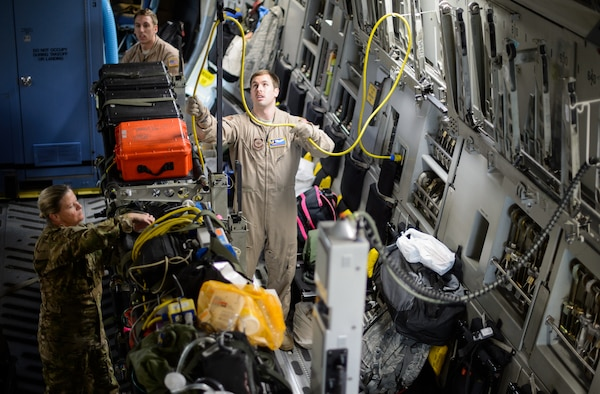 Tech. Sgt. Derek Matway, 10th Expeditionary Aeromedical Evacuation Squadron technician, sets up medical equipment inside a C-17 Globemaster III, Nov. 10, 2015, at Ramstein Air Base, Germany. Matway and a crew of medical Airmen flew to a deployed location in Southwest Asia to retrieve service members in need of medical attention. (U.S. Air Force photo/Staff Sgt. Armando A. Schwier-Morales)