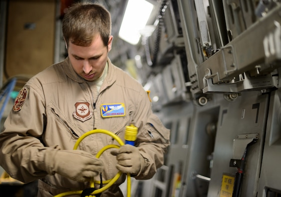 Tech. Sgt. Derek Matway, 10th Expeditionary Aeromedical Evacuation Flight technician, configures power for medical equipment Nov. 10, 2015, at Ramstein Air Base, Germany. Aeromedical evacuation Airmen can use a variety of aircraft in the Air Force arsenal to get the injured home and save lives. The aircraft powers the equipment needed to treat all types of injuries mid-flight. (U.S. Air Force photo/Staff Sgt. Armando A. Schwier-Morales)