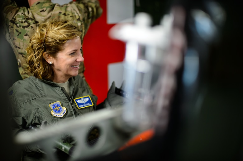 Lt. Col. Barb Marshall, 10th Expeditionary Aeromedical Evacuation Flight chief nurse, carries a litter in preparation for an aeromedical evacuation sortie Nov. 10, 2015, at Ramstein Air Base, Germany. The flying crew and other members of the 10th EAEF help set up an aircraft to ensure medical personnel took off on time. (U.S. Air Force photo/Staff Sgt. Armando A. Schwier-Morales)