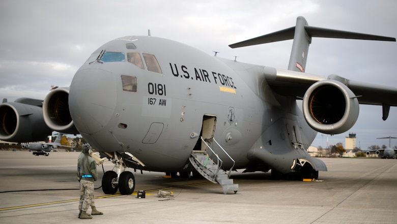Crew chiefs from the 521st Air Mobility Operations Wing stand beside a C-17 Globemaster III prior to an aeromedical evacuation mission Nov. 10, 2015, at Ramstein Air Base, Germany. The 521st AMOW, including the 10th Expeditionary Aeromedical Evacuation Flight, conducts regular missions to the U.S. Central Command area of operation to return wounded warriors home. (U.S. Air Force photo/Staff Sgt. Armando A. Schwier-Morales)