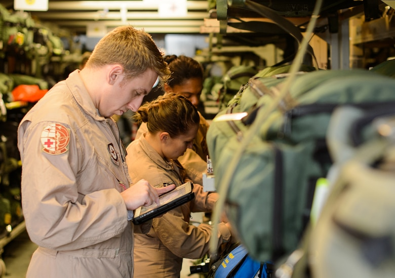 Senior Airmen Ryan Rieth, left, Beverly Spencer, center, and Master Sgt. Natalia Stockhausen, all 10th Expeditionary Aeromedical Evacuation Flight technicians, inventory medical equipment Nov. 10, 2015, at Ramstein Air Base, Germany. The three technicians helped treat and care for patients midair as they are returned from deployed locations for higher level medical treatment. (U.S. Air Force photo/Staff Sgt. Armando A. Schwier-Morales)