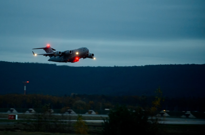 A C-17 Globemaster III carrying medical personnel from the 10th Expeditionary Aeromedical Evacuation Flight takes off Nov. 10, 2015, at Ramstein Air Base, Germany. The 10th EAEF is a mixture of active, reserve and guard Airmen deployed to Ramstein, constantly flying to war zones to retrieve patients needing higher levels of medical care. (U.S. Air Force photo/Staff Sgt. Armando A. Schwier-Morales)
