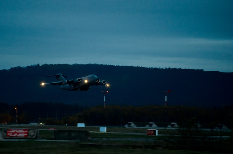 A C-17 Globemaster III carrying medical personnel from the 10th Expeditionary Aeromedical Evacuation Flight takes off Nov. 10, 2015, at Ramstein Air Base, Germany. The 10th EAEF is a mixture of active-duty, reserve and guard Airmen deployed to Ramstein, constantly flying to war zones to retrieve patients needing higher levels of medical care. (U.S. Air Force photo/Staff Sgt. Armando A. Schwier-Morales)