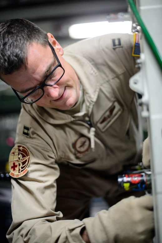 Capt. Benjamin Schultze, 10th Expeditionary Aeromedical Evacuation Flight nurse, secures a litter carrying medical equipment Nov. 10, 2015, at Ramstein Air Base, Germany. After configuring the inside of the C-17 Globemaster III into a flying ambulance, the Airmen test their equipment to ensure they can provide the best possible treatment while flying thousands of feet in the air. The 10th EAEF is a mixture of active-duty, reserve and guard Airmen deployed to Ramstein, constantly flying to war zones to retrieve patients needing higher levels of medical care. (U.S. Air Force photo/Staff Sgt. Armando A. Schwier-Morales)
