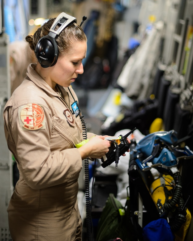 Senior Airman Beverly Spencer, 10th Expeditionary Aeromedical Evacuation Flight technician, checks a radio's service Nov. 10, 2015, at Ramstein Air Base, Germany. After configuring the inside of the C-17 Globemaster III into a flying ambulance, the Airmen test their equipment to ensure they can provide the best possible treatment while flying thousands of feet in the air. The 10th EAEF is a mixture of active-duty, reserve and guard Airmen deployed to Ramstein, constantly flying to war zones to retrieve patients needing higher levels of medical care. (U.S. Air Force photo/Staff Sgt. Armando A. Schwier-Morales)