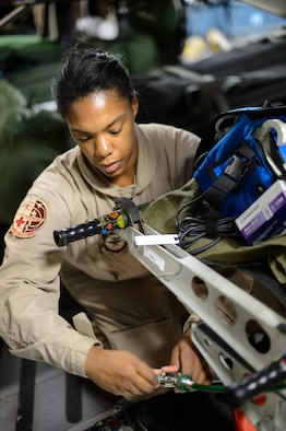 Master Sgt. Natalia Stockhausen, 10th Expeditionary Aeromedical Evacuation Flight technician, connects medical equipment to a C-17 Globemaster III's systems Nov. 10, 2015, at Ramstein Air Base, Germany. After configuring the inside of the C-17 Globemaster III into a flying ambulance, the Airmen test their equipment to ensure they can provide the best possible treatment while flying thousands of feet in the air. The 10th EAEF is a mixture of active-duty, reserve and guard Airmen deployed to Ramstein, constantly flying to war zones to retrieve patients needing higher levels of medical care. (U.S. Air Force photo/Staff Sgt. Armando A. Schwier-Morales)