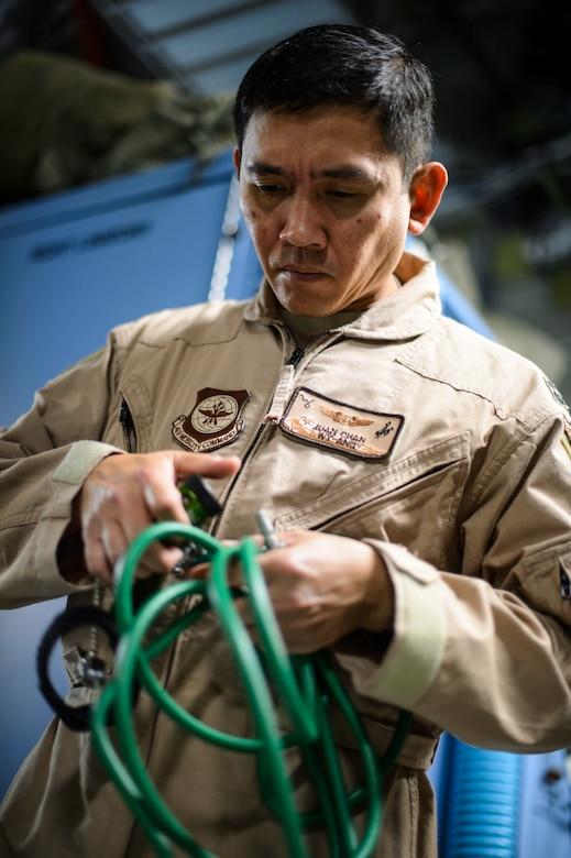 Capt. Juan Chan, 10th Expeditionary Aeromedical Evacuation Flight nurse, conducts a pre-flight test on medical equipment Nov. 10, 2015, at Ramstein Air Base, Germany. After configuring the inside of the C-17 Globemaster III into a flying ambulance, the Airmen test their equipment to ensure they can provide the best possible treatment while flying thousands of feet in the air. The 10th EAEF is a mixture of active-duty, reserve and guard Airmen deployed to Ramstein, constantly flying to war zones to retrieve patients needing higher levels of medical care. (U.S. Air Force photo/Staff Sgt. Armando A. Schwier-Morales)