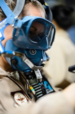 Senior Airman Beverly Spencer, 10th Expeditionary Aeromedical Evacuation Flight technician, tests her oxygen mask for leaks prior to a flight Nov. 10, 2015, at Ramstein Air Base, Germany. After configuring the inside of the C-17 Globemaster III into a flying ambulance, the Airmen test their equipment to ensure they can provide the best possible treatment while flying thousands of feet in the air. The 10th EAEF is a mixture of active-duty, reserve and guard Airmen deployed to Ramstein, constantly flying to war zones to retrieve patients needing higher levels of medical care. (U.S. Air Force photo/Staff Sgt. Armando A. Schwier-Morales)