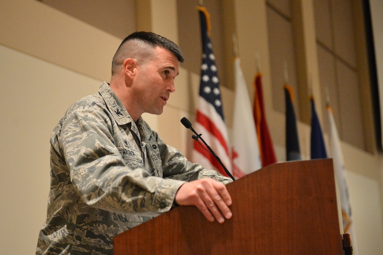 Col. John Wagner, 460th Space Wing commander, speaks to Team Buckley members during the Veterans Day ceremony at the Leadership Development Center Nov. 13, 2015, on Buckley Air Force Base, Colo. The ceremony included a guest speaker and a flag-folding ceremony performed by the Aerospace Data Facility-Colorado Joint Color Guard. (U.S. Air Force photo by Staff Sgt. Darren Scott/Released)