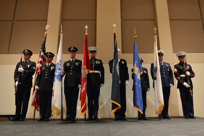 Members of the Aerospace Data Facility-Colorado Joint Color Guard post colors during the Veterans Day ceremony at the Leadership Development Center Nov. 13, 2015, on Buckley Air Force Base, Colo. The ceremony included a guest speaker and a flag-folding ceremony performed by the ADF-C joint color guard. (U.S. Air Force photo by Staff Sgt. Darren Scott/Released)