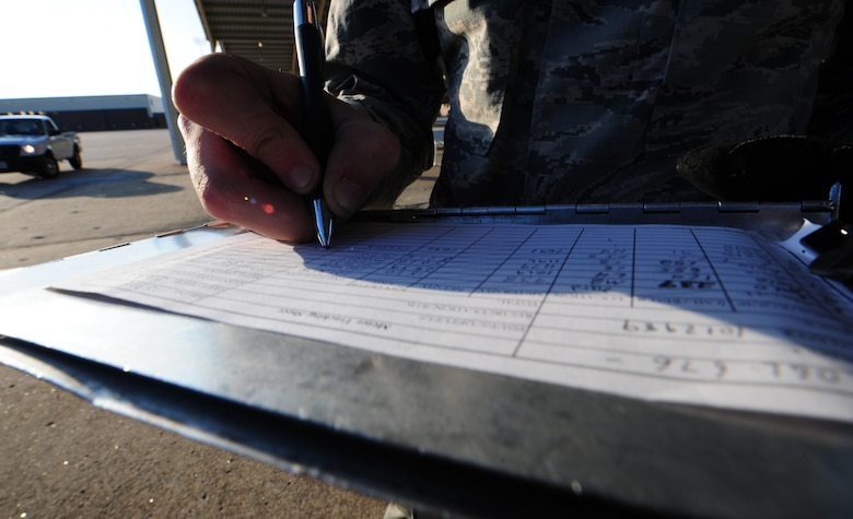U.S. Air Force Airman 1st Class Jacob McSheffrey, a 509th Logistics Readiness Squadron fuels distribution operator, fills out an Air Force Form 1998, fuels billing transaction, at Whiteman Air Force Base, Mo., Nov. 3, 2015. This process ensures the appropriate agencies are billed for the fuels issued. (U.S. Air Force photo by Senior Airman Keenan Berry)