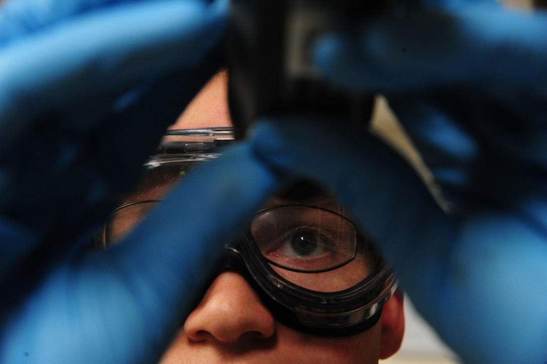 U.S. Air Force Staff Sgt. Nicholas Flamm, a 509th Logistics Readiness Squadron fuels service center operator, utilizes a refractometer to measure fuel system icing inhibitor (FSII) levels at Whiteman Air Force Base, Mo., Nov. 3, 2015. This process ensures the FSII levels meet the Air Force specifications and keeps ice crystals from forming in the fuel during flight. (U.S. Air Force photo by Senior Airman Keenan Berry)