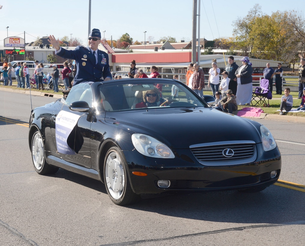 Air Force Sustainment Center Commander Lt. Gen. Lee Levy II waves to the crowd during the 2015 Midwest City Veterans Day Parade Wednesday. General Levy served as the parade's grand marshal.  (Air Force photo by Kelly White/Released)