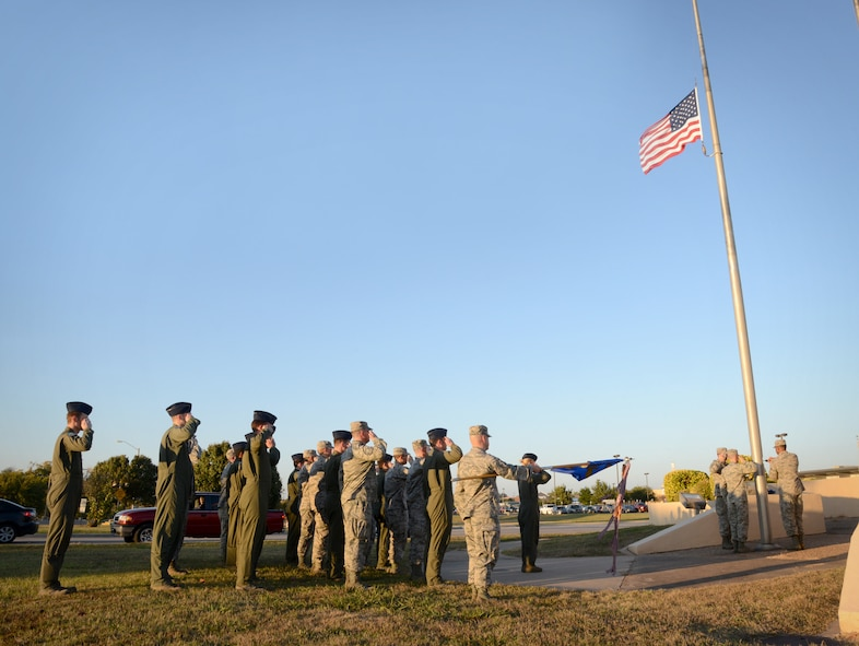 Members of the 552nd Air Control Wing's Operations Group participated in a base retreat ceremony on Nov. 3. Led by 960th Airborne Air Control Squadron Commander Lt. Col. Kristen D. Thompson, the 24-member group stood at attention as the flag was lowered and folded by the Tinker Honor Guard. (Air Force photo by Kelly White/Released)