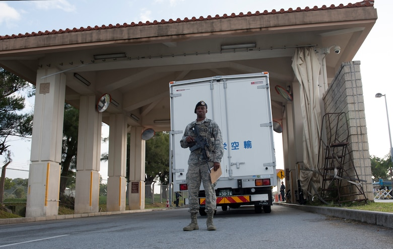 U.S. Air Force Airman 1st Class Alvin Stewart, 18th Security Forces Squadron response force member, waits for trucks to arrive to a search pit Nov. 10, 2015, at Kadena Air Base, Japan. An Air Force Smart Operations for the 21st Century team on Kadena implemented an earlier search time for commercial vehicles to keep them from congesting traffic while waiting to get on base. (U.S. Air Force photo by Airman 1st Class Lynette M. Rolen)
