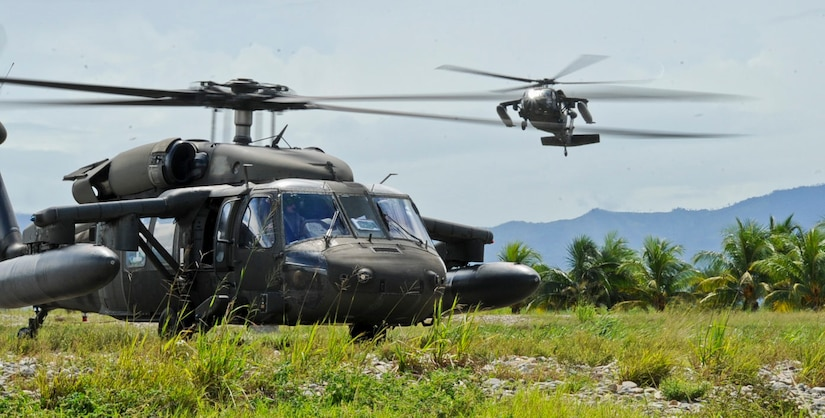 Two UH-60 Blackhawks assigned to the 1-228th Aviation Regiment at Soto Cano Air Base, Honduras, fulfill a request from the Honduran Military to provide airlift for a troop rotation, Nov. 4, 2015, in the Gracias a Dios department (state) of Honduras. The U.S. has supported the Honduran request since October 2014, and is a partnership to allow greater freedom of movement for the Honduran military in remote areas of the country. (U.S. Air Force photo by Capt. Christopher J. Mesnard/Released)