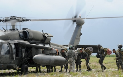A U.S. Army UH-60 Blackhawk provides support to Honduras during Operation CARAVANA XIII, Nov. 4, 2015, in the Gracias a Dios department (state) of Honduras. The U.S. has provided airlift support at the request of the Honduran government since October 2014, enabling the Honduran military greater freedom of operation to counter drug trafficking and related criminal activities. (U.S. Air Force photo by Capt. Christopher J. Mesnard/Released)