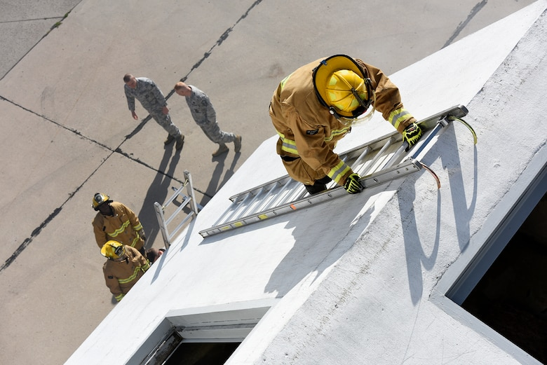 A U.S. Air National Guard firefighter assigned to the 180th Fighter Wing ascends a ladder during a Regularly Scheduled Drill training exercise Nov. 7, 2015 in Swanton, Ohio at a specialized training facility owned by the Toledo Fire Department. The 180th Fighter Wing partners with the Toledo Fire Department and other civil authorities to share resources and maximize training benefits. (U.S. Air National Guard photo by Staff Sgt. Shane Hughes/Released)