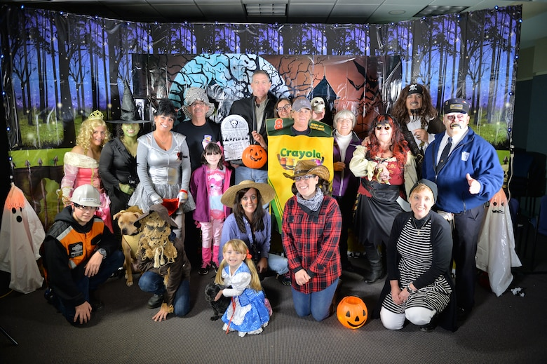 WESTHAMPTON BEACH, NY- The 106th Rescue Wing Family Readiness Group volunteers gather for a picture at the bases first annual Trunk-or-Treat, October 24th, 2015.   106th Rescue Wing members, family and friends came out in support of the base's first Halloween event coordinated by the Family Readiness Group.  (U.S. Air National Guard / Master Sgt. Cheran Cambridge / released)