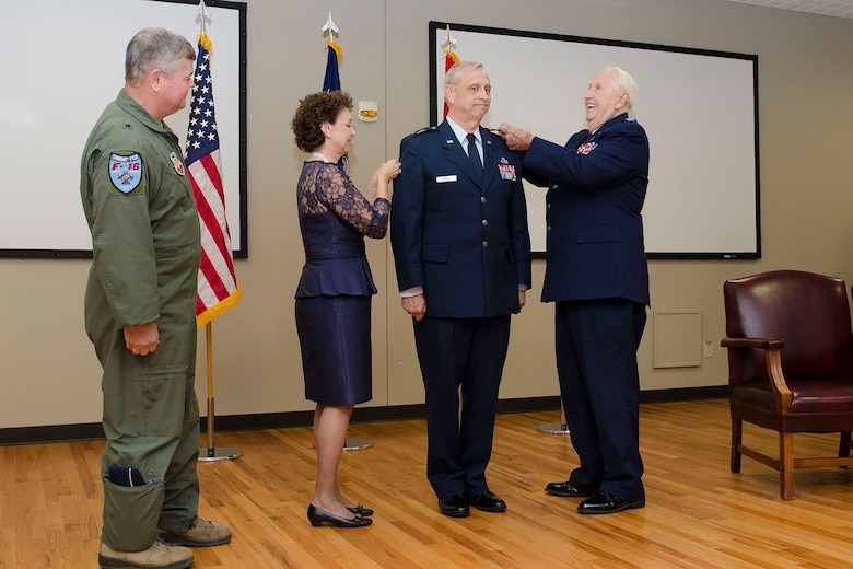 U.S. Air Force Col. Russell Rushe, Assistant Adjutant General for Air, Joint Forces Headquarters, S.C., is promoted to Brig. Gen. during a ceremony at McEntire Joint National Guard Base, Nov. 8, 2015. (U.S. Air National Guard photo by Tech. Sgt. Jorge Intriago/RELEASED)