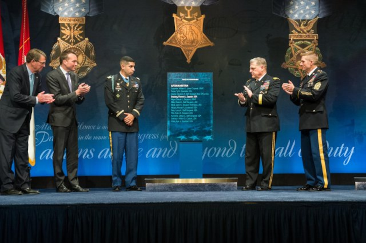 Defense Secretary Ash Carter, acting Army Secretary Eric K. Fanning, Medal of Honor recipient retired Army Capt. Florent A. Groberg, Army Chief of Staff Gen. Mark A. Milley and Sgt. Maj. of the Army Daniel A. Dailey unveil the plaque bearing Groberg's name during Groberg's Hall of Heroes induction ceremony at the Pentagon, Nov. 13, 2015. Groberg received the Medal of Honor for risking his life and going above and beyond the call of duty while serving as a personal security detachment commander for Task Force Mountain Warrior, 4th Infantry Brigade Combat Team, 4th Infantry Division, during combat operations in Afghanistan's Kunar province on Aug. 8, 2012. U.S. Army photo by Staff Sgt. Steve Cortez