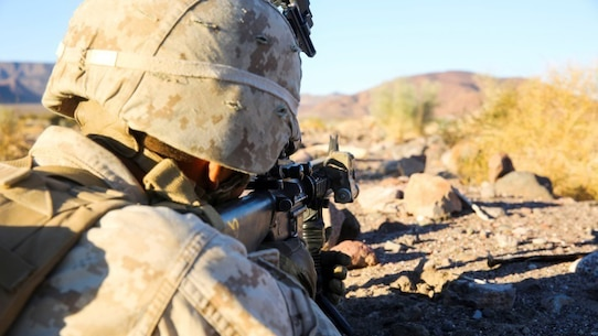 A Marine with Charlie Company, 1st Battalion, 8th Marine Regiment sights in during the defensive phase of the Battalion Assault Course, the culminating event for Integrated Training Exercise 1-16 aboard Marine Corps Air Ground Combat Center, Twentynine Palms, Calif., Nov. 6, 2015. The BAC assessed a battalion's ability to conduct offensive and defensive operations integrating elements from the Air Combat Element and Logistics Combat Element.