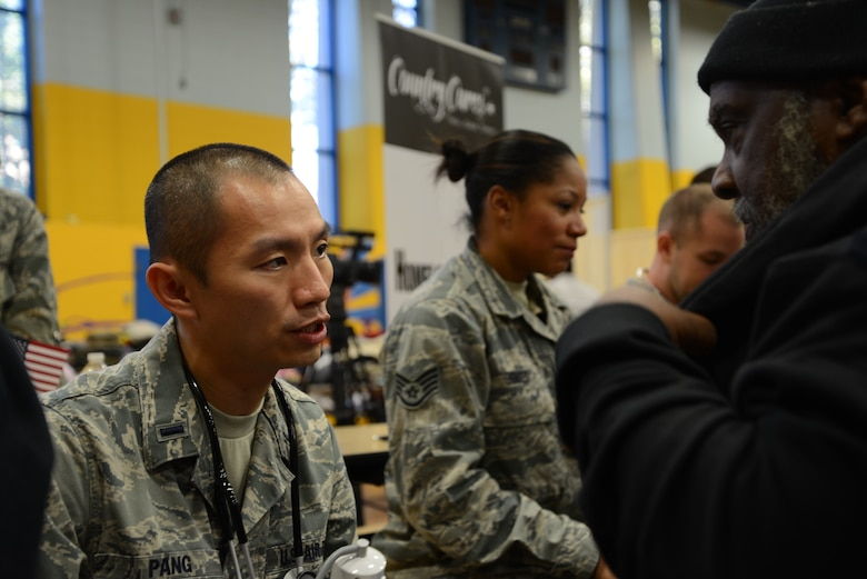1st Lt. Stan Pang, 108th Medical Group, New Jersey Air National Guard, checks the blood pressure of a homeless veteran at the New Jersey Department of Military and Veterans Affairs Stand Down Day at the John F. Kennedy recreation center in Newark, N.J. On Oct. 10, 2015. The stand down day allows the veterans to get much needed care and services from a wide array of state agencies and nonprofit organizations. Members of the 108th Medical Group have been providing care at stand down days for more than 10 years and were providing blood pressure checks as a means to have conversations with the veterans about their overall health and wellness. Stand Down is a military term referring to exhausted combat units that were removed from the battlefront to a place of security and safety for rest and recovery. Today, Stand Downs are grass roots, community-based intervention program to help veterans' battle life on the streets. (U.S. Air National Guard photo by Master Sgt. Carl Clegg, Released)