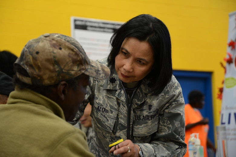 Lt. Col. Mauricia Alo, 108th Medical Group, New Jersey Air National Guard, checks the blood pressure of a homeless veteran at the New Jersey Department of Military and Veterans Affairs Stand Down Day at the John F. Kennedy recreation center in Newark, N.J. On Oct. 10, 2015. The stand down day allows the veterans to get much needed care and services from a wide array of state agencies and nonprofit organizations. Members of the 108th Medical Group have been providing care at stand down days for more than 10 years and were providing blood pressure checks as a means to have conversations with the veterans about their overall health and wellness. Stand Down is a military term referring to exhausted combat units that were removed from the battlefront to a place of security and safety for rest and recovery. Today, Stand Downs are grass roots, community-based intervention program to help veterans' battle life on the streets. (U.S. Air National Guard photo by Master Sgt. Carl Clegg, Released)