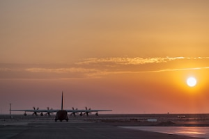 A U.S. Marine Corps Hercules aircraft taxis along a runway at sunset in the U.S. Central Command area of responsibility, Nov. 5, 2015. The four-engine turboprop military transport aircraft provides support to U.S. and coalition forces of Combined Joint Task Force – Operation Inherent Resolve. U. S. Marine Corps photo by Staff Sgt. Nathan O. Sotelo