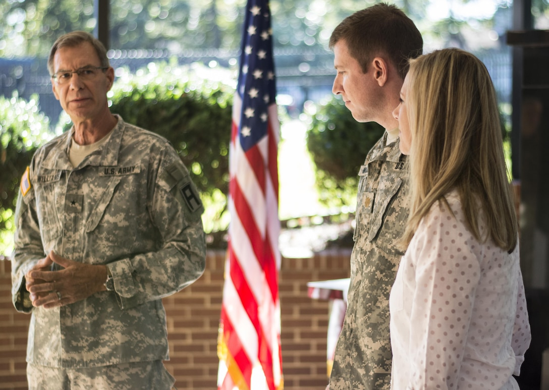 Retired Brig. Gen. Blake Williams delivers his remarks during the promotion ceremony for his son, Maj. Mark Williams on Oct. 18, 2015. Blake Williams and his sons, Mark Williams and Capt. Ryan Williams (not shown) have over four decades of service in the Army Reserve. Blake Williams previously served in the 108th Training Command (IET), the same unit both his sons are currently assigned to. (Photo by Sgt. Ken Scar, 108th Training Command (IET), Public Affairs)