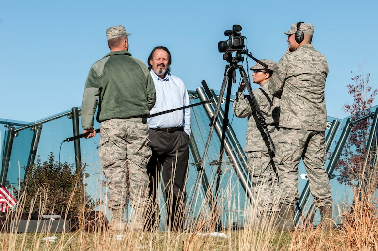 U.S. Airmen, assigned to the 140th Public Affairs Office, interview Rick Crandall, president of the Colorado Freedom Memorial, about how the Memorial was inspired and built in Aurora, Colo. May 14, 2015.  The memorial honors Colorado men and women killed in action since Colorado first became a state. (U.S. Air National Guard Senior Airman Bobbie Reynolds)