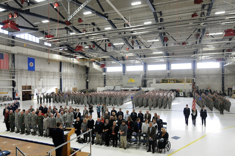 Airmen from the 148th Fighter Wing, Duluth, Minn. and guests stand at attention before Col. Jon S. Safstrom accepts command of the Wing, Nov. 14, 2015. Safstrom assumed command from Col. Frank H. Stokes who accepted a position at the National Guard Bureau, Arlington, Va. (U.S. Air Force photo by Tech. Sgt. Amie Muller/released)