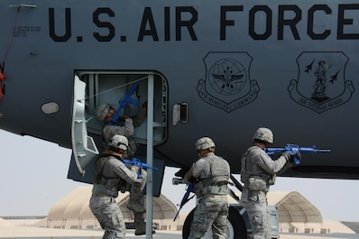 Airmen from the 379th Expeditionary Security Forces Squadron tactically approach the entrance of a KC-135 Stratotanker during a force protection exercise at Al Udeid Air Base, Qatar Nov. 12. The exercise featured U.S. Air Force airmen and Qatar Emir Air Force airmen working together to apprehend the suspect of an attempted aircraft hijacking. (U.S. Air Force photo by Tech. Sgt. James Hodgman)