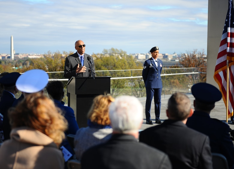 Retired Gen. Larry O. Spencer, the Air Force Association president, addresses the crowd during a Veterans Day ceremony beneath the spires of the Air Force Memorial Nov. 11, 2015. Veterans and their families reflected on the sacrifices made by the Soldiers, Sailors, Airmen and Marines, who have defended and continue to defend the U.S., its allies and coalition partners. (U.S. Air Force photo/Tech. Sgt. Bryan Franks)