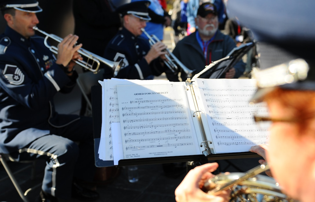 """The Air Force Quintet performs the """"Armed Forces Medley"""" as veterans stand up during their services' songs at the Veterans Day ceremony at the Air Force Memorial Nov. 11, 2015. It's estimated that 7 percent of the U.S. population are veterans and only 1 percent currently serve on behalf of the nation. (U.S. Air Force photo/Tech. Sgt. Bryan Franks)"""