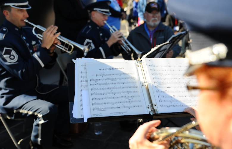 "The Air Force Quintet performs the ""Armed Forces Medley"" as veterans stand up during their services' songs at the Veterans Day ceremony at the Air Force Memorial Nov. 11, 2015. It's estimated that 7 percent of the U.S. population are veterans and only 1 percent currently serve on behalf of the nation. (U.S. Air Force photo/Tech. Sgt. Bryan Franks)"