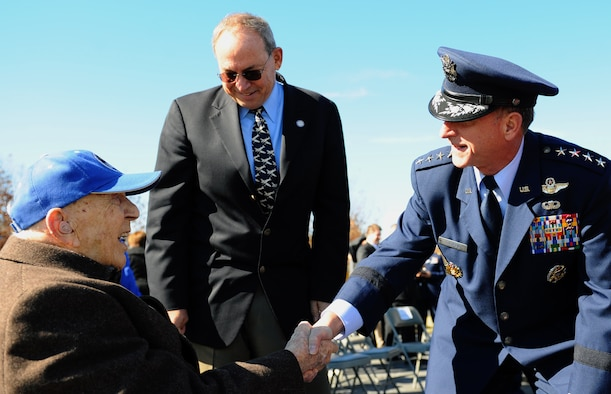Air Force Vice Chief of Staff Gen. David L. Goldfein greets retired Lt. Col. Alfred Deptula, an aircraft engineer during World War II, after the Veterans Day ceremony at the Air Force Memorial Nov. 11, 2015. The event provided an opportunity for veterans and their families to reflect on the sacrifices made in service of the nation. (U.S. Air Force photo/Tech. Sgt. Bryan Franks)
